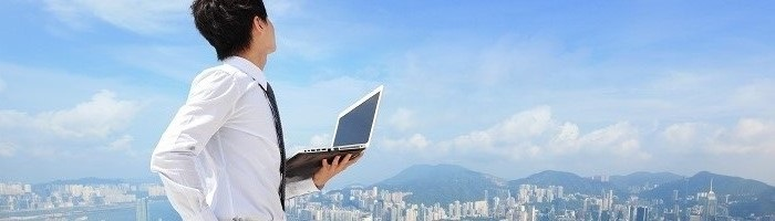 Young business man using laptop and look to cityscape, asian, hong kong