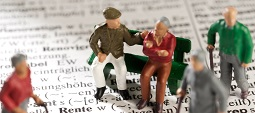 "Model figures of old people on a dictionary with the word ""Rente"""